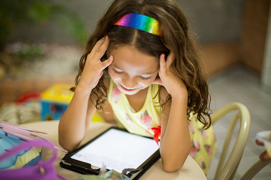 Image of child using a tablet computer.