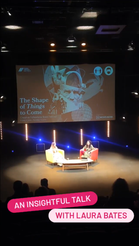 A view of two women on stage in an auditorium, under a screen saying 'The Shape of Things to Come'. A talk with author Laura Bates.
