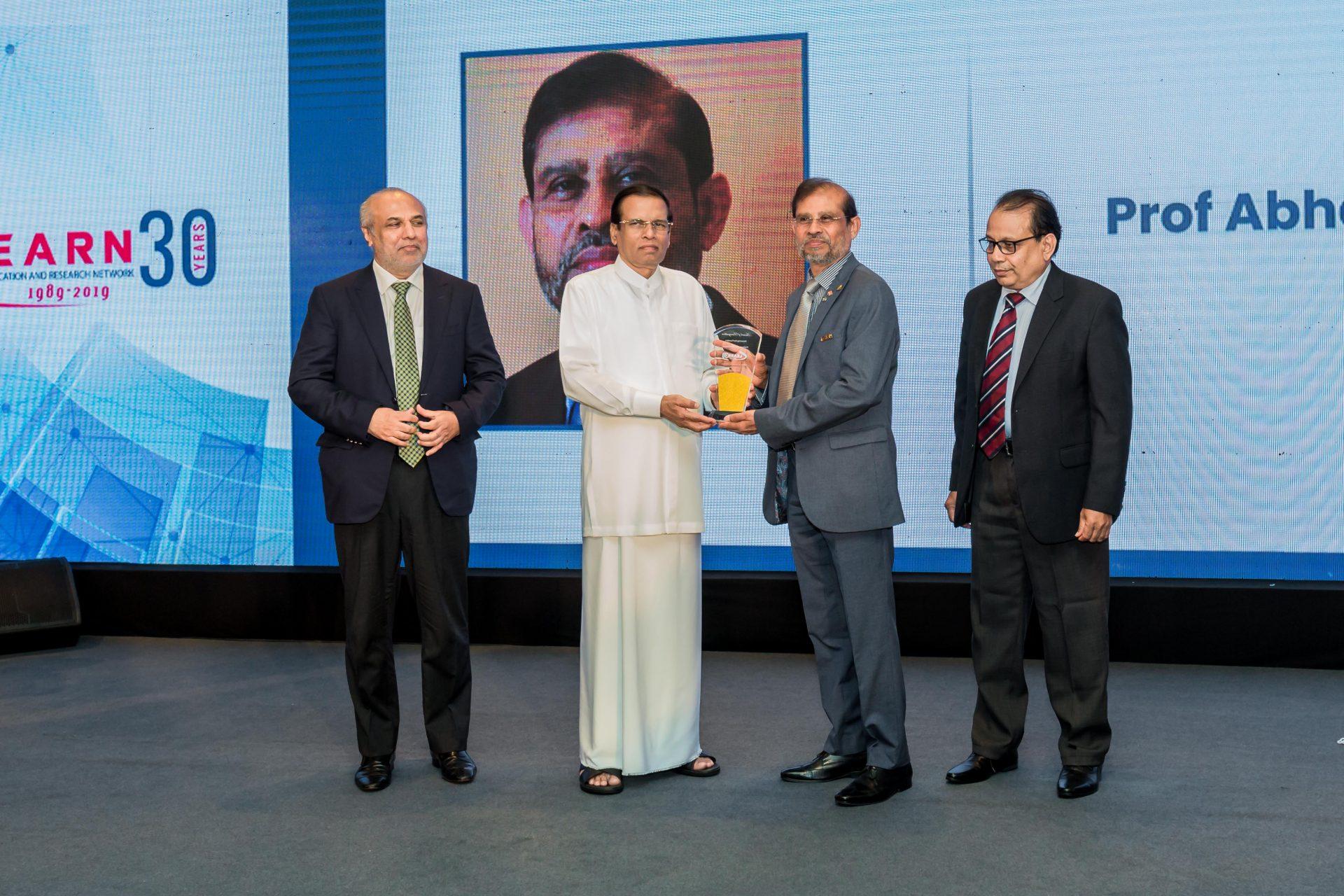 Abhaya Receiving LEARN 30 Anniversary Award