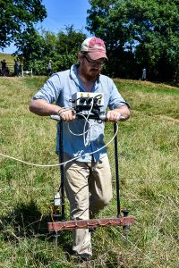 Dr Darrell Rohl conducting a resistivity geophysical survey as part of the 2017 CCCU Archaeological Field School