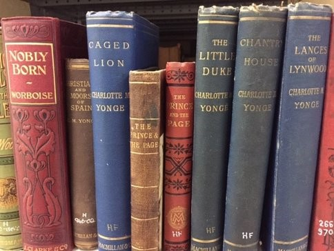 Image shows shelf containing books by Charlotte Yonge