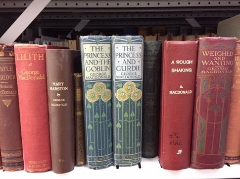 Image shows shelf containing books by George MacDonald