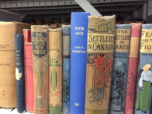 Image shows shelf of books by Captain Marryat