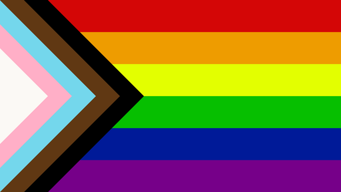 The LGBT flag, including black, brown, light blue, light pink and white stripes