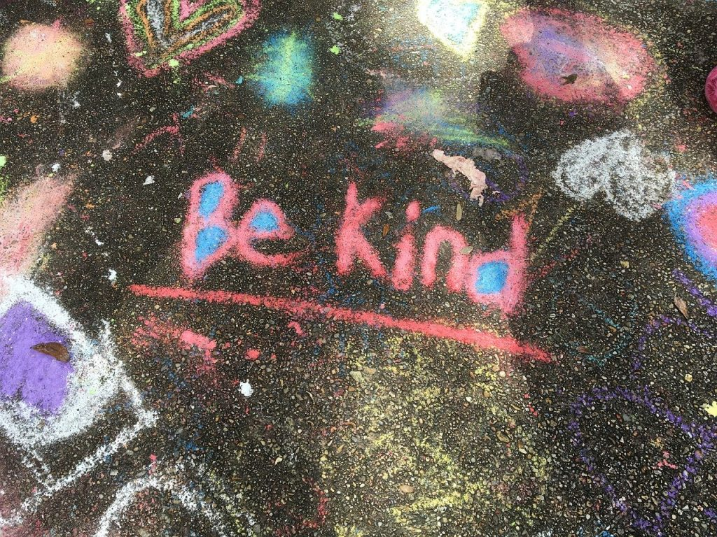 A pavement with be kind written in chalk