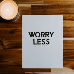 a document with worry less written on it representing worry