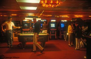 Arcade with pool table and slot machines